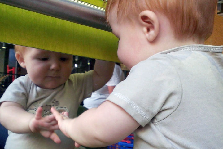 Your Baby is Now Fascinated By Her Own Reflection