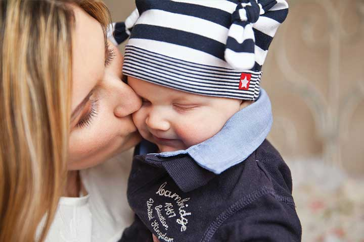 Aww! Your Baby's Getting Mushy With Kisses and Hugs