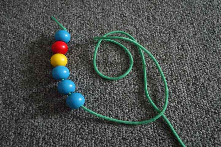 Your Toddler Is Now Able To String Large Beads