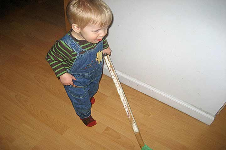 Your Little One Will Try To Help You Sweep The Floor Using A Small Sized Broom